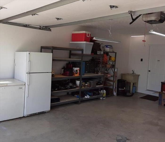 Clean garage with fresh paint after fire damage