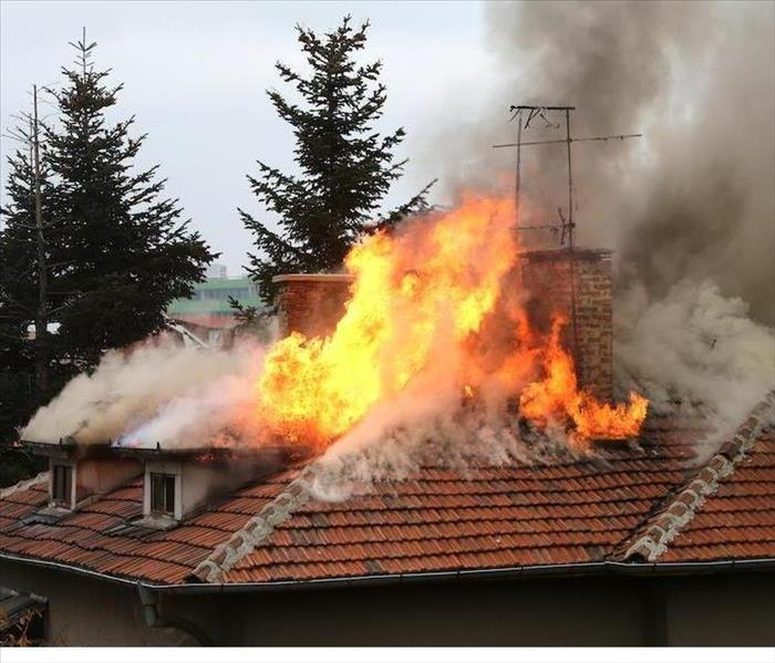 A Fire Burns The Roof of a Home